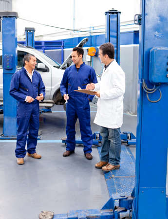 Car mechanics at the repair shop talking Stock Photo - 12824577