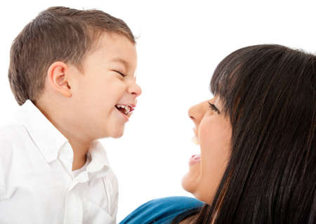 Portrait of a happy mother and son laughing - isolated over a white background photo