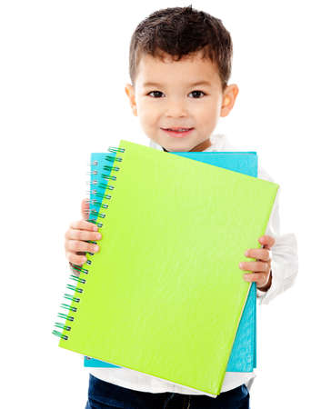 Little boy going to school holding notebooks - isolated over a white background photo