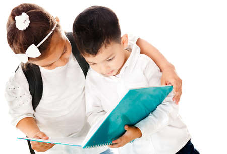 Preschool kids holding a notebook - isolated over a white background photo