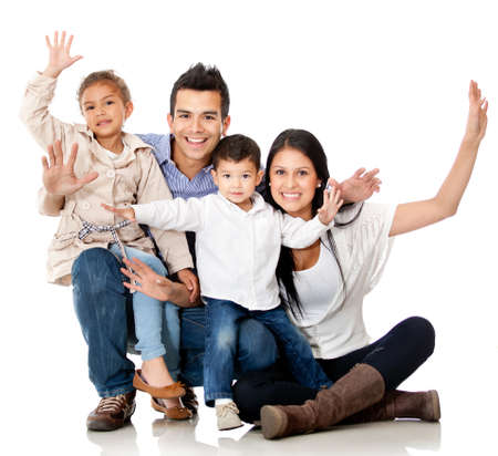people celebrating: Happy family smiling with arms up - isolated over a white background