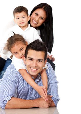 hispanic boy: Hermosa familia est� acostado - aislados en un fondo blanco