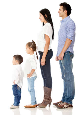 Family standing in a row - isolated over a white background photo