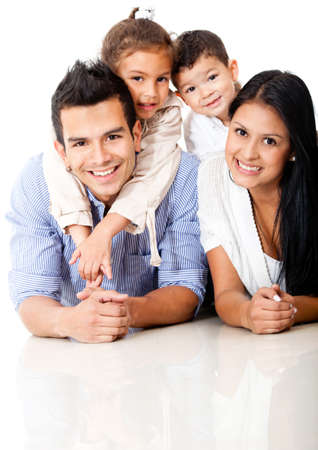 hispanic male: Beautiful family portrait lying on the floor and smiling