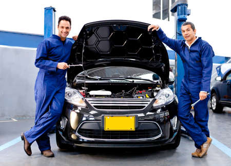 Mechanics at a car repair shop fixing an engine  photo