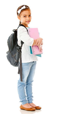 Primary school girl widh notebooks and backpack - isolated over white  photo