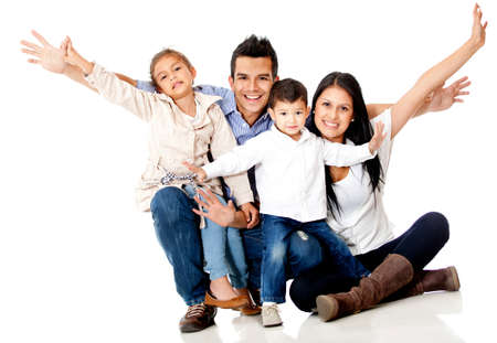 Happy family smiling with arms up - isolated over a white background  photo