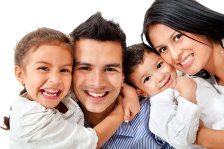 latin family: Happy family portrait smiling - isolated over a white background  Stock Photo