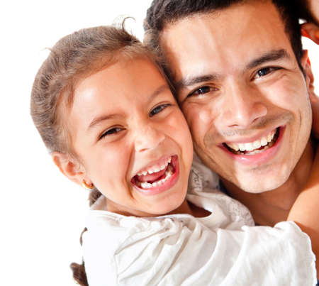 Affectionate father and daughter smiling - isolated over a white background photo
