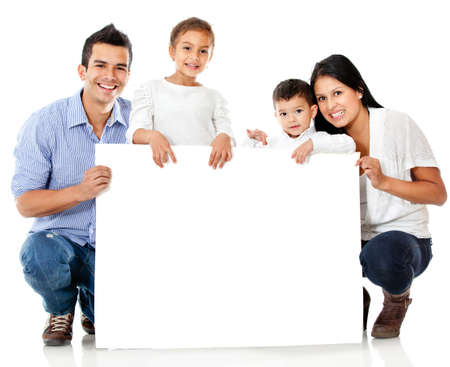 Family holding a banner and smiling - isolated over a white background  photo