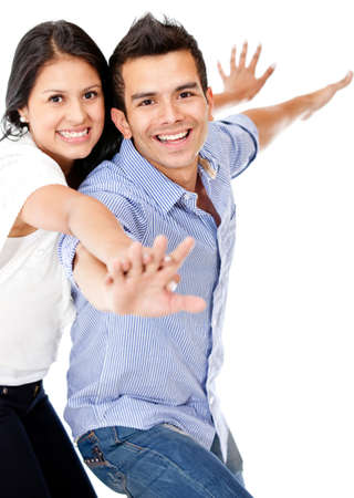 Happy couple with arms open - isolated over a white background photo