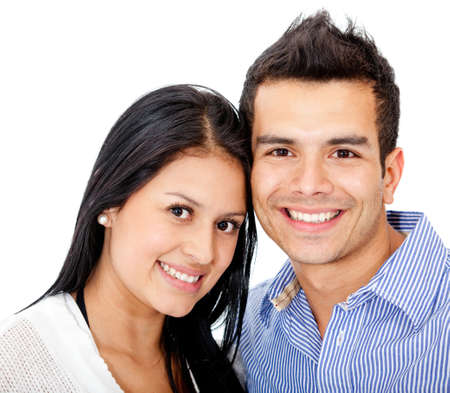 hispanic women: Young loving couple smiling - isolated over a white background