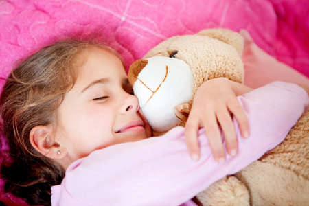 sleeping kid: Cute little girl sleeping with a teddy bear