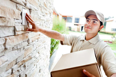 Happy delivery man outdoors ringing house doorbell Stock Photo - 12824495