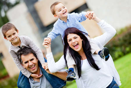 Happy family having fun running outdoors and smiling  photo