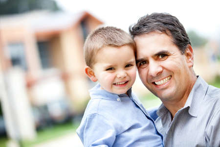 Happy portrait of a father and son smiling - outdoors photo