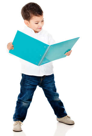 student reading: Cute little boy reading a book - isolated over a white background