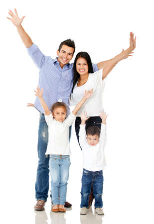 Happy family celebrating with arms up - isolated over a white background photo
