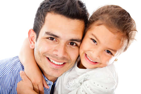 Father and daughter smiling - isolated over a white background photo