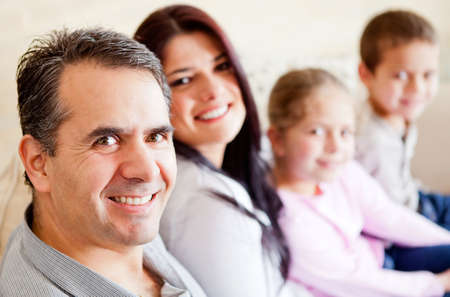 Happy man wih his family at home smiling  photo