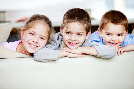 Happy group of children smiling at home  photo