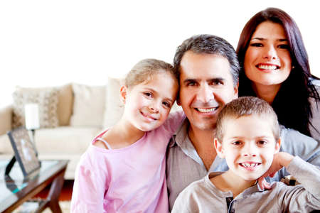 Beautiful family portrait smiling at home and looking happy  Stock Photo - 12824466