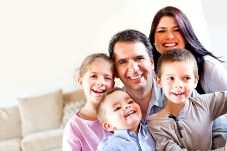 Happy family portrait having fun at home and smiling  photo