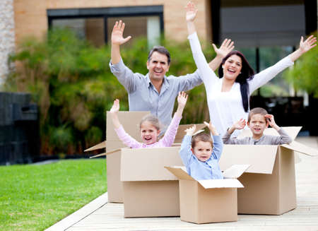 post box: Happy family in cardboard boxes moving house