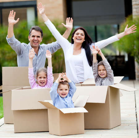 Family with arms up celebrating they are moving home  photo