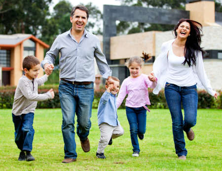 Beautiful family having fun running outdoors and smiling  photo