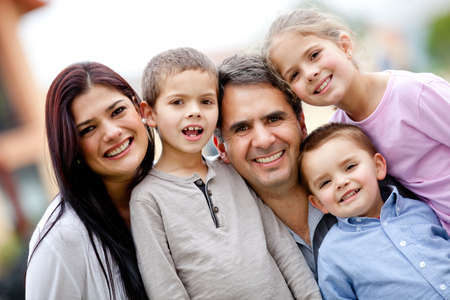 Five member family portrait looking happy  Stock Photo - 12824399