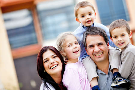Beautiful family portrait smiling and looking very happy  Stock Photo - 12824394