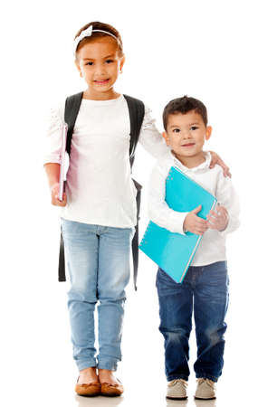 School children holding notebooks - isolated over a white background photo