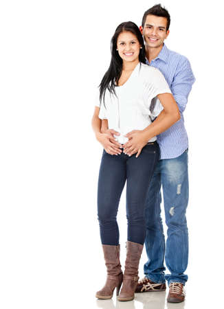 Happy young couple smiling - isolated over a white background photo