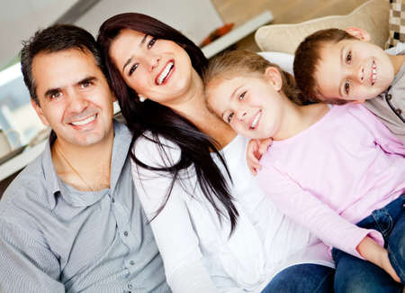 Portrait of a lovely family together at home smiling  photo