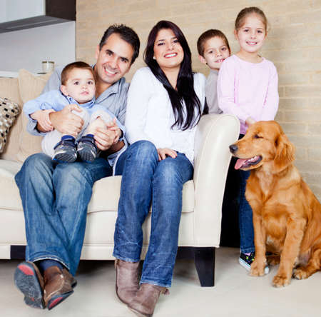 large group of animals: Big family at home with a dog, all looking very happy