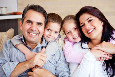 Portrait of a happy family smiling at home  Stock Photo - 12824420