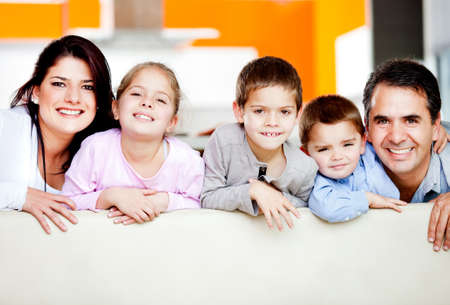 Cute family portrait with three kids smiling Stock Photo - 12824435