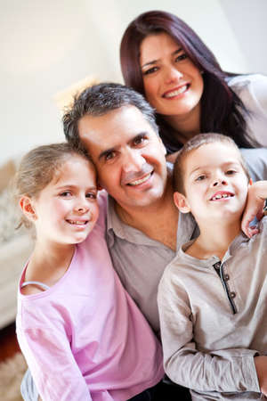 Loving family portrait together at home smiling photo
