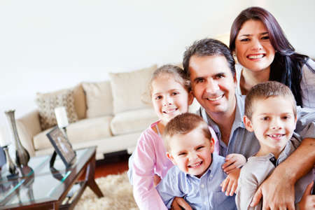 Happy family together in the living room  Stock Photo - 12824401