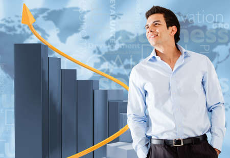 Successful businessman with a bar graph showing growth  photo