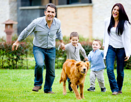 Happy family running at the backyard and having fun  photo