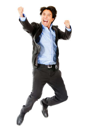 Successful business man celebrating and jumping - isolated over white  photo