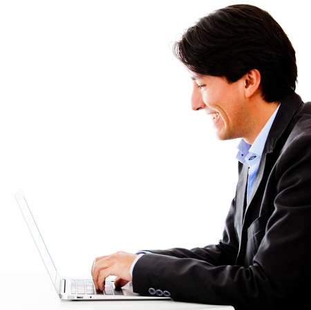 Businessman with a laptop - isolated over a white background  Stock Photo - 13153242