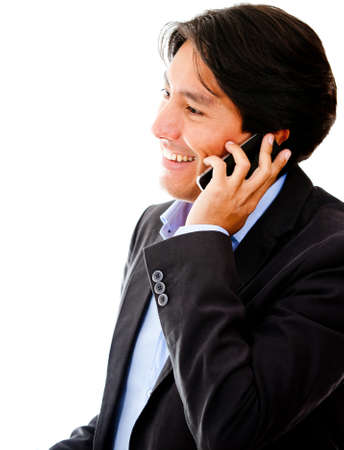 Businessman talking on the phone - isolated over a white background photo