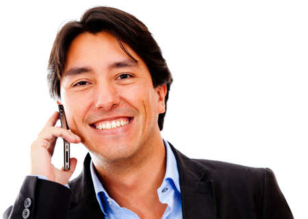 Business man on his cell phone - isolated over a white background photo