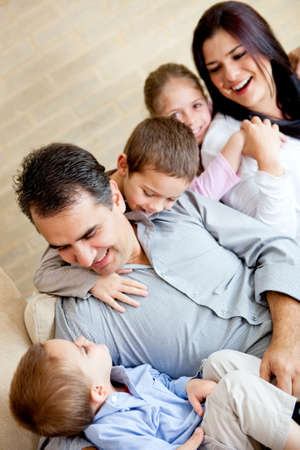 Lovely family having fun at home and smiling  Stock Photo - 13153605