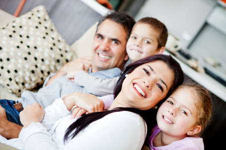 Beautiful family portrait spending time together at home  photo