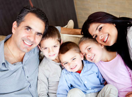 Beautiful family portrait smiling indoors at home  Stock Photo - 13153466