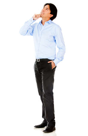 Thoughtful businessman looking up - isolated over a white background photo